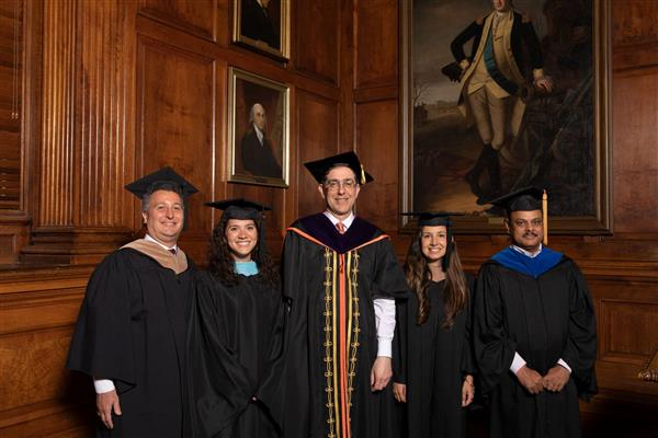 Princeton University president Christopher L. Eisgruber (center) congratulates four outstanding New